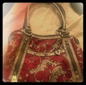 Like new Red and gold floral print Purse.